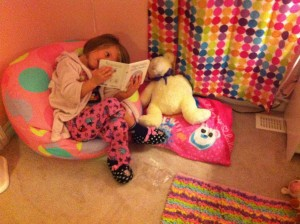 Reading her teddy a bedtime story. I mean, come on.